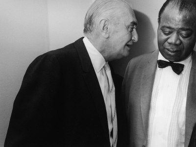 manager-joe-glaser-conferring-with-client-musician-louis-armstrong-after-a-concert