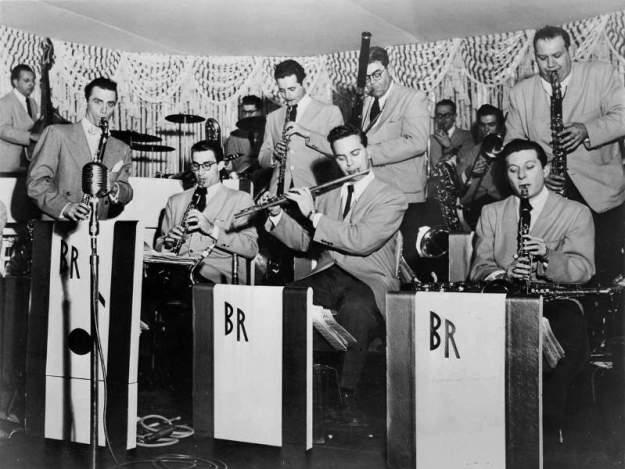 Photo by courtesy of Joffe woodwinds' article    Boyd Raeburn Saxes in 1947, (Courtesy of Bruce Raeburn) Front Row L-R: Boyd Raeburn, Buddy DeFranco, Abe Markowitz, Frank Socolow Back Row L-R: Sam Spumberg, Shirley Thompson, Hy Mandel